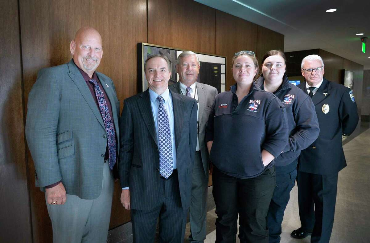 Sen. Curt VanderWall, R-Ludington, stops for a photo with members of the Michigan Association of Ambulance Services after the Senate Health Policy and Human Services Committee meeting on Thursday. The committee approved Senate Resolution 51, which would acknowledge May 16-22, 2021, as EMS Week in the state of Michigan. (Courtesy photo)