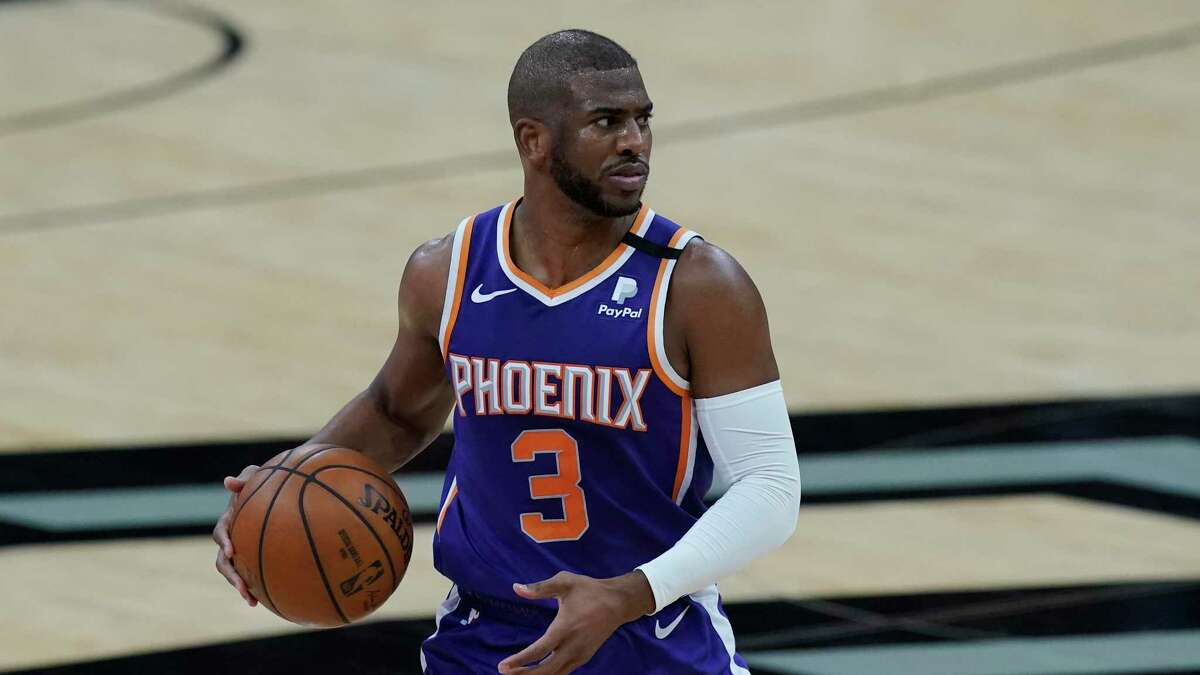 Chris Paul, right, helped transform the Suns to the No. 2 seed in the Western Conference playoffs and a 51-21 record.