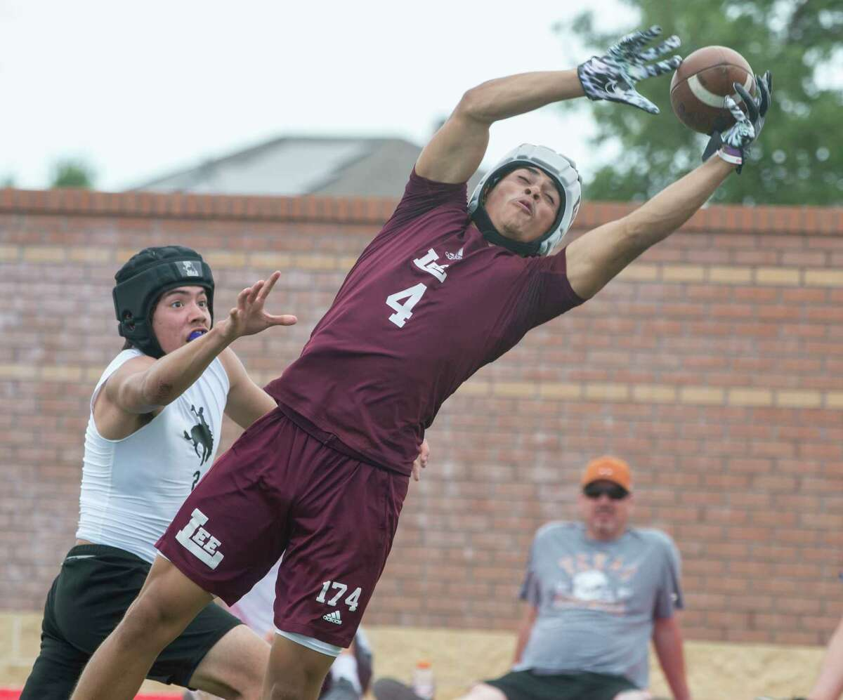 Lee High's Donny Bishop can't bring in a catch for a touchdown in front of a Lubbock High defender 5/22/2021 in the championship 7-on-7 football game on the auxiliary fields at Scharbauer Sports Complex. Tim Fischer/Reporter-Telegram