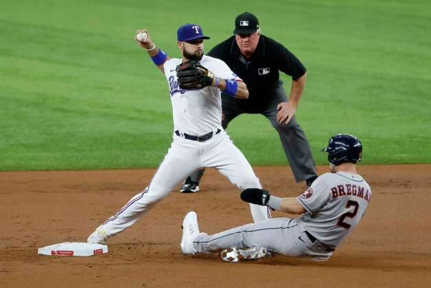Texas Rangers shortstop Isiah Kiner-Falefa, left, forces out Houston Astros' Alex Bregman (2) during the first inning of a baseball game Saturday, May 22, 2021, in Arlington, Texas. (AP Photo/Michael Ainsworth) Photo: Michael Ainsworth, Associated Press / Copyright 2021 The Associated Press. All rights reserved.