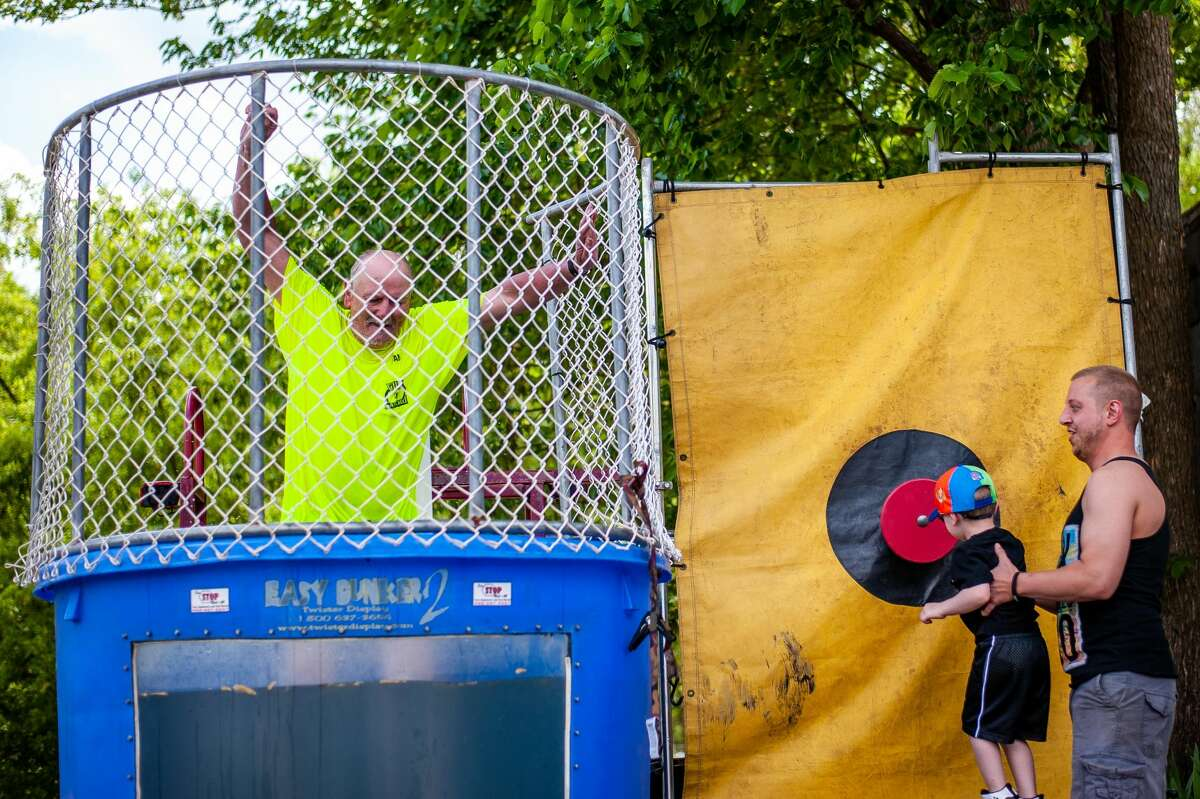 Sanford resident Sam Lehehgets dunked into a water tank at the Sanford Rising event on Saturday, May 22, 2021.