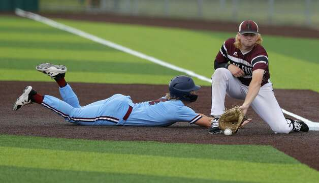 Cy-Fair first baseman Nolan Wilson (22) fields a throw to first as Will Stark #4 of Katy Tompkins reaches base in the first inning during Game 3 of a Region II-6A high school baseball quarterfinal series at Tomball Memorial High School, Saturday, May 22, 2021, in Tomball. Photo: Jason Fochtman/Staff Photographer / 2021 © Houston Chronicle