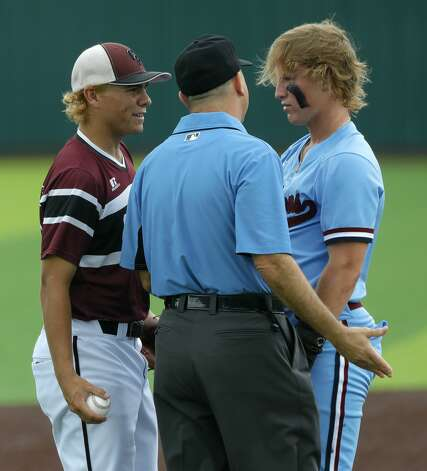 Will Stark #4 of Katy Tompkins has some words with Cy-Fair third baseman Trevor Sebek (15) after Tompkins collides with Sevek's knee while stealing third in the first inning during Game 3 of a Region II-6A high school baseball quarterfinal series at Tomball Memorial High School, Saturday, May 22, 2021, in Tomball. Photo: Jason Fochtman/Staff Photographer / 2021 © Houston Chronicle
