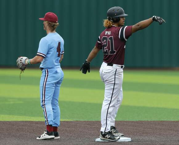 Josh Martinez #21 of Cy-Fair gestures toward the dugout after hitting a double in the second inning during Game 3 of a Region II-6A high school baseball quarterfinal series at Tomball Memorial High School, Saturday, May 22, 2021, in Tomball. Photo: Jason Fochtman/Staff Photographer / 2021 © Houston Chronicle