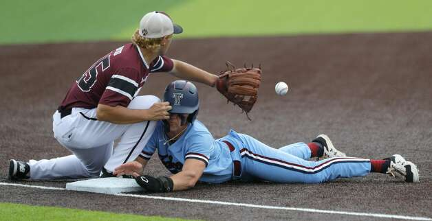 Will Stark #4 of Katy Tompkins collides with the knee of Cy-Fair third baseman Trevor Sebek (15) while stealing third in the first inning during Game 3 of a Region II-6A high school baseball quarterfinal series at Tomball Memorial High School, Saturday, May 22, 2021, in Tomball. Photo: Jason Fochtman/Staff Photographer / 2021 © Houston Chronicle