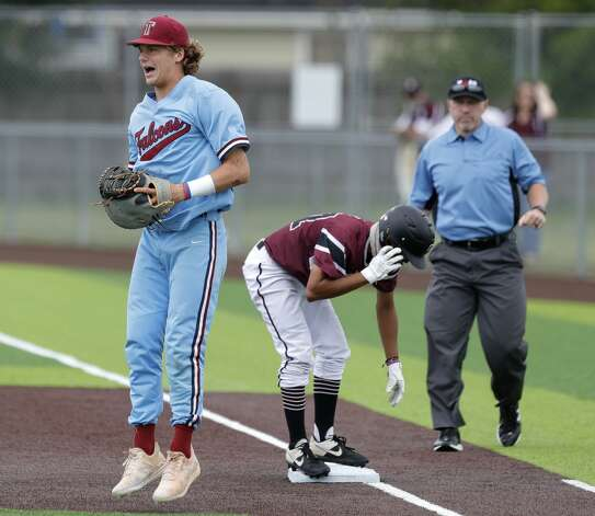 Cy-Fair first baseman Nolan Wilson (22) reacts after catching the throw from catcher Drew Markte (9) to pick-off Kevin Luna # 17 of Cy-Fair in the third inning during Game 3 of a Region II-6A high school baseball quarterfinal series at Tomball Memorial High School, Saturday, May 22, 2021, in Tomball. Photo: Jason Fochtman/Staff Photographer / 2021 © Houston Chronicle