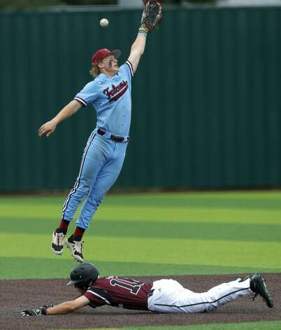 Katy Tompkins shortstop Graden West (17) tries to field a throw to second as Alex Dunagan #16 of Cy-Fair slides safely in the fourth inning during Game 3 of a Region II-6A high school baseball quarterfinal series at Tomball Memorial High School, Saturday, May 22, 2021, in Tomball. Photo: Jason Fochtman/Staff Photographer / 2021 © Houston Chronicle