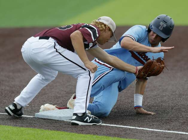 Jack Little #22 of Katy Tompkins steals third base ahead of the tag from Cy-Fair third baseman Trevor Sebek (15) in the third inning during Game 3 of a Region II-6A high school baseball quarterfinal series at Tomball Memorial High School, Saturday, May 22, 2021, in Tomball. Photo: Jason Fochtman/Staff Photographer / 2021 © Houston Chronicle