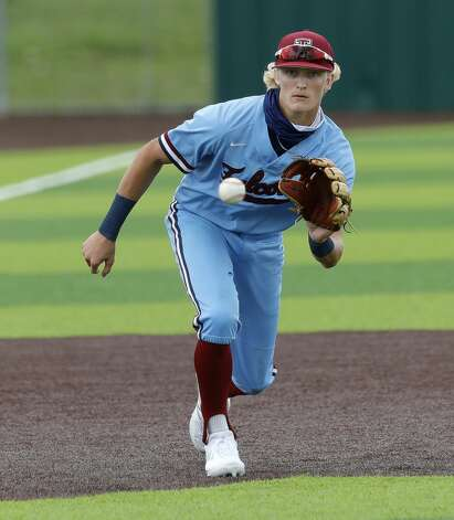 Katy Tompkins third baseman Drew Markte (9) fields a ground ball in the fifth inning during Game 3 of a Region II-6A high school baseball quarterfinal series at Tomball Memorial High School, Saturday, May 22, 2021, in Tomball. Photo: Jason Fochtman/Staff Photographer / 2021 © Houston Chronicle