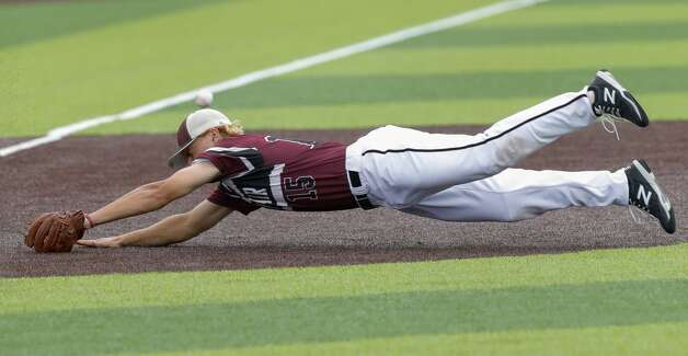 Cy-Fair third baseman Trevor Sebek (15) attempts to field a single by Jace LaViolette #12 of Katy Tompkins in the fifth inning during Game 3 of a Region II-6A high school baseball quarterfinal series at Tomball Memorial High School, Saturday, May 22, 2021, in Tomball. Photo: Jason Fochtman/Staff Photographer / 2021 © Houston Chronicle