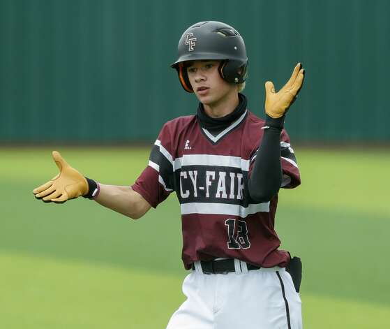 Connor Rodriguez #18 of Cy-Fair reacts after reaching first after an error by Katy Tompkins shortstop Graden West (17) in the sixth inning during Game 3 of a Region II-6A high school baseball quarterfinal series at Tomball Memorial High School, Saturday, May 22, 2021, in Tomball. Photo: Jason Fochtman/Staff Photographer / 2021 © Houston Chronicle