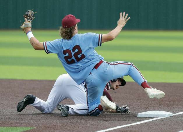 Katy Tompkins first baseman Jack Little (22) taggs out Alex Dunagan #16 of Cy-Fair after a pickoff in the sixth inning during Game 3 of a Region II-6A high school baseball quarterfinal series at Tomball Memorial High School, Saturday, May 22, 2021, in Tomball. Photo: Jason Fochtman/Staff Photographer / 2021 © Houston Chronicle