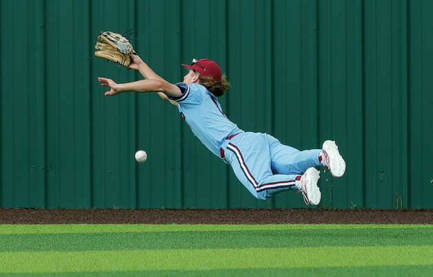 Katy Tompkins left fielder Tyler Brownlee (11) tries to field a double by Conner Brooks #4 of Cy-Fair in the seventh inning during Game 3 of a Region II-6A high school baseball quarterfinal series at Tomball Memorial High School, Saturday, May 22, 2021, in Tomball. Photo: Jason Fochtman/Staff Photographer / 2021 © Houston Chronicle