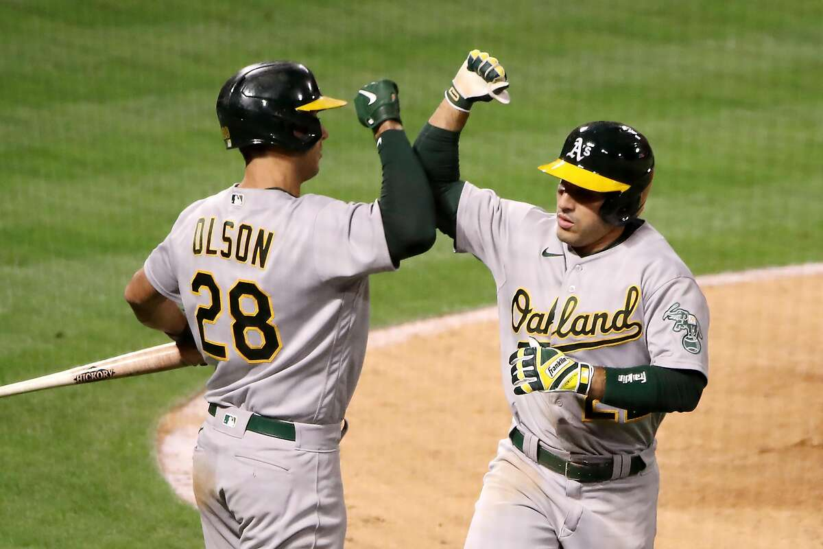 ANAHEIM, CALIFORNIA - MAY 21: Ramon Laureano #22 of the Oakland Athletics celebrates his home run with Matt Olson #28 against the Los Angeles Angels during the ninth inning at Angel Stadium of Anaheim on May 21, 2021 in Anaheim, California. (Photo by Katelyn Mulcahy/Getty Images)