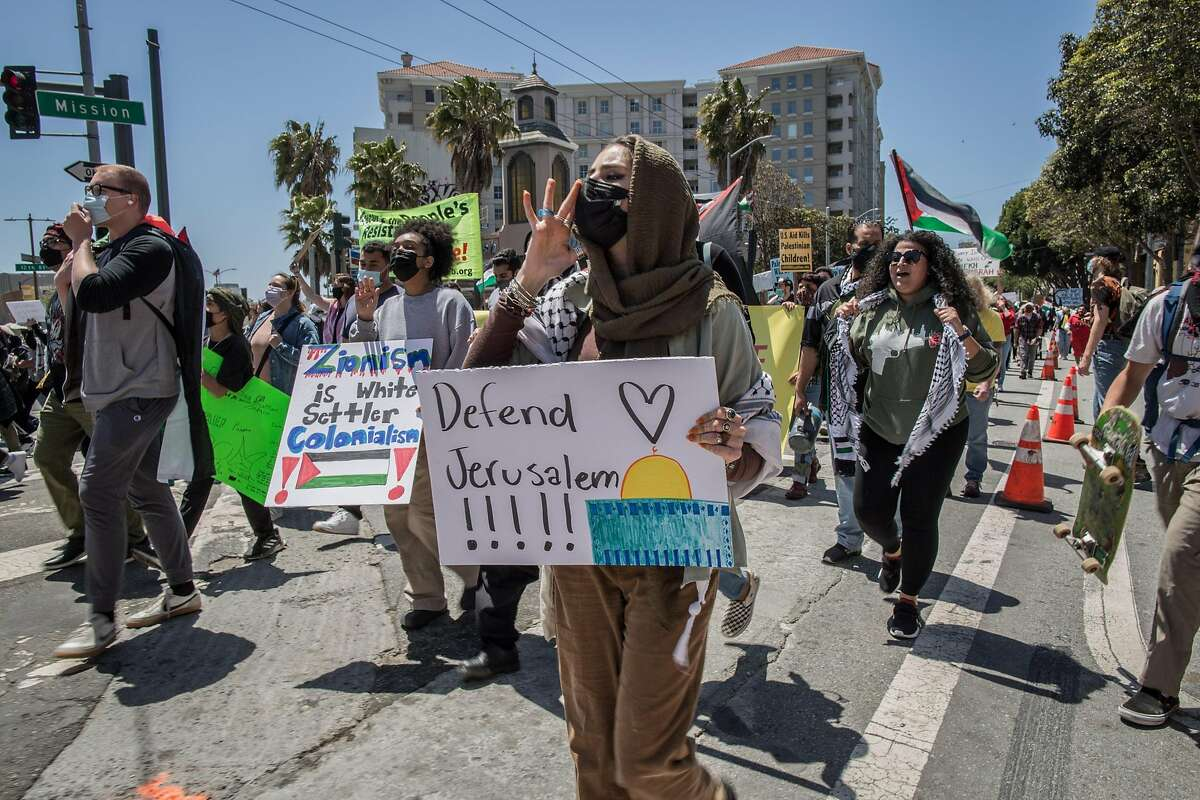 Hundreds of people in Civic Center protest Israeli occupation of the West Bank during a march Saturday in San Francisco. Special to The Chronicle