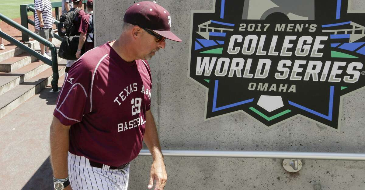 Texas A&M coach Rob Childress walks past a College World Series banner following team practice in Omaha, Neb., Friday, June 16, 2017. Texas A&M plays Louisville in the NCAA baseball College World Series on Sunday. (AP Photo/Nati Harnik)