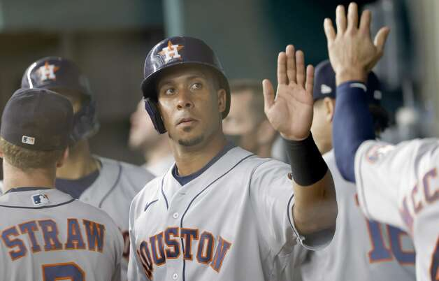 ARLINGTON, TX - MAY 22: Michael Brantley #23 of the Houston Astros celebrates with teammates after scoring a run against the Texas Rangers during the first inning at Globe Life Field on May 22, 2021 in Arlington, Texas. (Photo by Ron Jenkins/Getty Images) Photo: Ron Jenkins/Getty Images / 2021 Getty Images