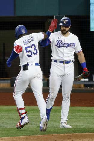 Texas Rangers' Adolis Garcia (53) is congratulated by Joey Gallo, right, after his solo home run against the Houston Astros during the fifth inning of a baseball game Saturday, May 22, 2021, in Arlington, Texas. (AP Photo/Michael Ainsworth) Photo: Michael Ainsworth/Associated Press / Copyright 2021 The Associated Press. All rights reserved.