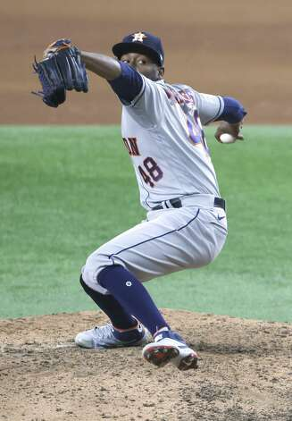 ARLINGTON, TX - MAY 22: Enoli Paredes #48 of the Houston Astros pitches against the Texas Rangers during the seventh inning at Globe Life Field on May 22, 2021 in Arlington, Texas. (Photo by Ron Jenkins/Getty Images) Photo: Ron Jenkins/Getty Images / 2021 Getty Images