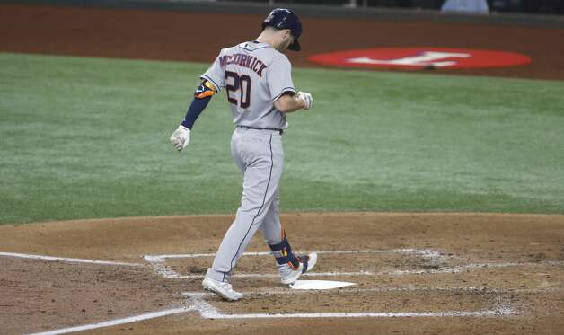ARLINGTON, TX - MAY 22: Chas McCormick #20 of the Houston Astros touches home plate after hitting a solo home run against the Texas Rangers during the second inning at Globe Life Field on May 22, 2021 in Arlington, Texas. (Photo by Ron Jenkins/Getty Images) Photo: Ron Jenkins/Getty Images / 2021 Getty Images