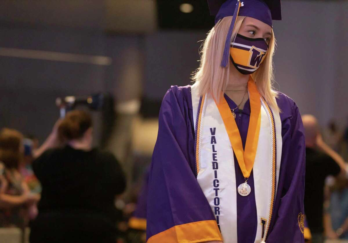 Class valedictorian Gracie Layne Harrison walks toward the stage during Booker T. Washington High School's graduation ceremony at The Ark Church, Saturday, May 22, 2021, in Conroe. This was the first graduating class of Washington High School since 1969.