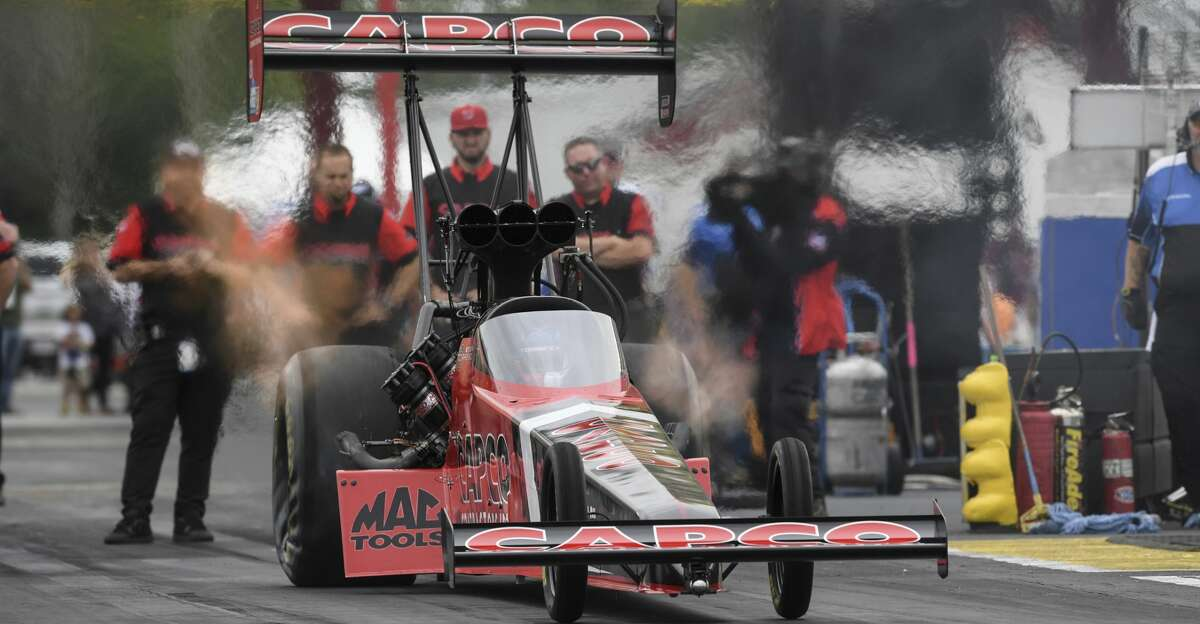 In this photo provided by the NHRA, Steve Torrence takes part in Top Fuel qualifying Saturday, May 22, 2021, for the Mopar Express Lane NHRA SpringNationals drag races at Houston Raceway Park in Baytown, Texas. (Jerry Foss/NHRA via AP)