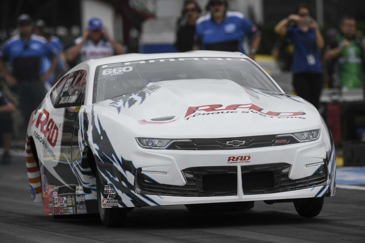 In this photo provided by the NHRA, Pro Stock rookie Dallas Glenn drives in qualifying Saturday, May 22, 2021, for the Mopar Express Lane NHRA SpringNationals drag races at Houston Raceway Park in Baytown, Texas. (Jerry Foss/NHRA via AP)