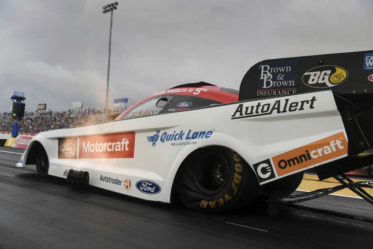 In this photo provided by the NHRA, Bob Tasca III makes a run in Funny Car qualifying Saturday, May 22, 2021, for the Mopar Express Lane NHRA SpringNationals drag races at Houston Raceway Park in Baytown, Texas. (Jerry Foss/NHRA via AP)