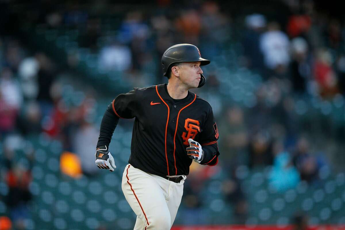 San Francisco Giants catcher Buster Posey (28) jogs around the bases for his two-run homer in the eighth inning during an MLB game against the Los Angeles Dodgers at Oracle Park, Saturday, May 22, 2021, in San Francisco, Calif.