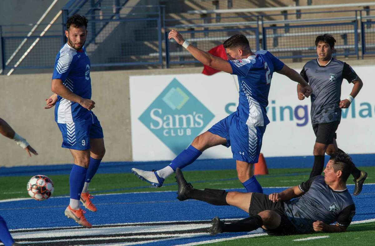 Sockers' Morgan Miller gets a shot off as a Brownsville player tries to slide in to knock the ball away 5/22/2021 at Grande Communications Stadium. Tim Fischer/Reporter-Telegram