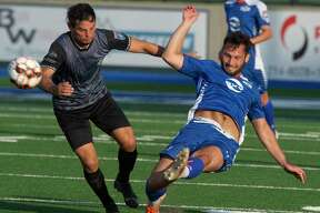 Sockers' Halil Yilmaz gets his foot on the ball to knock it away from Brownsville's Juan Ibarra 5/22/2021 at Grande Communications Stadium. Tim Fischer/Reporter-Telegram