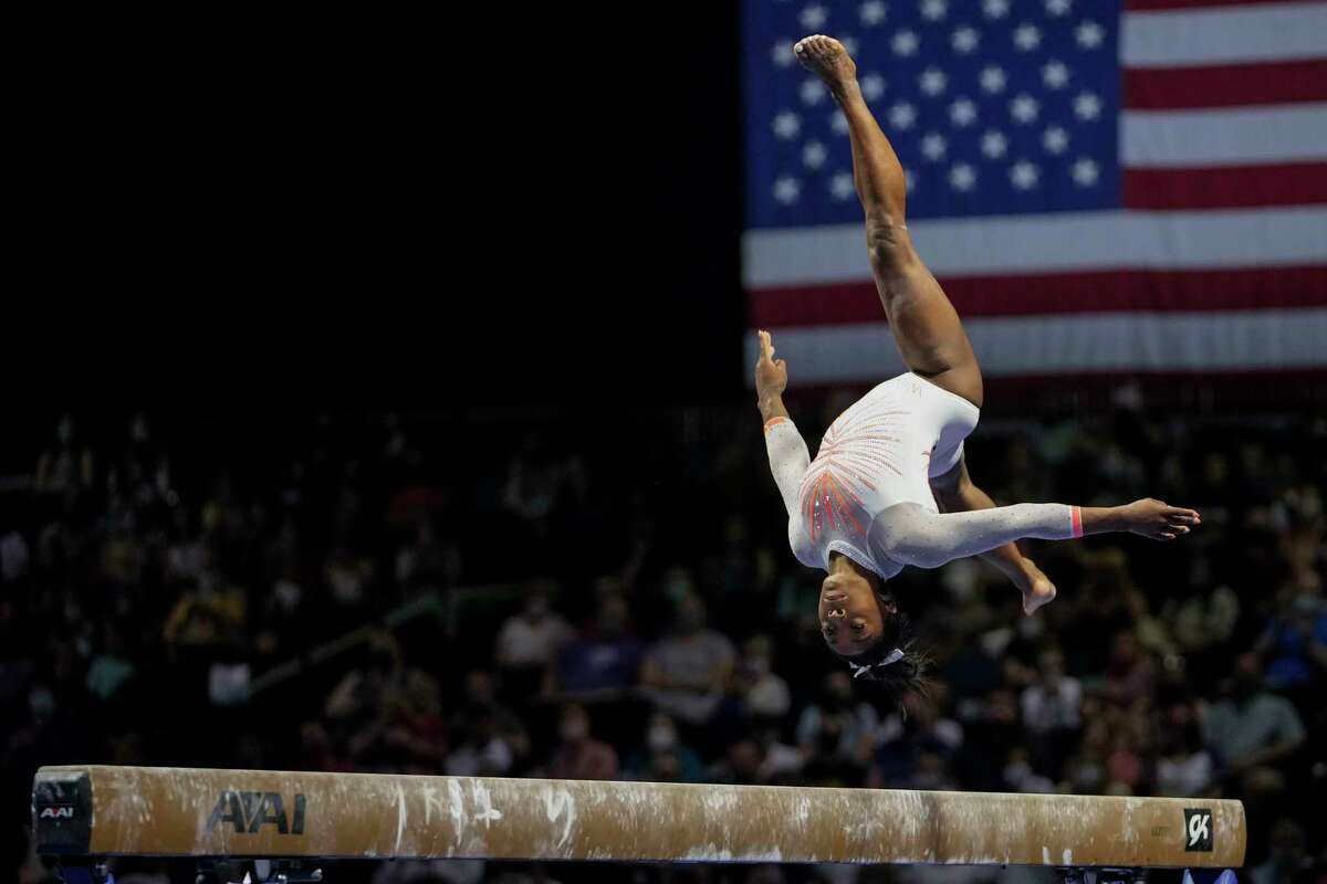Simone Biles performs her balance beam routine during the U.S. Classic gymnastics competition in Indianapolis, Saturday, May 22, 2021. (AP Photo/AJ Mast)