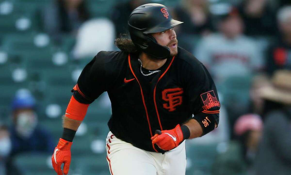 Shortstop Brandon Crawford, who was eligible to be a free agent, will be a Giant for at least two more seasons.