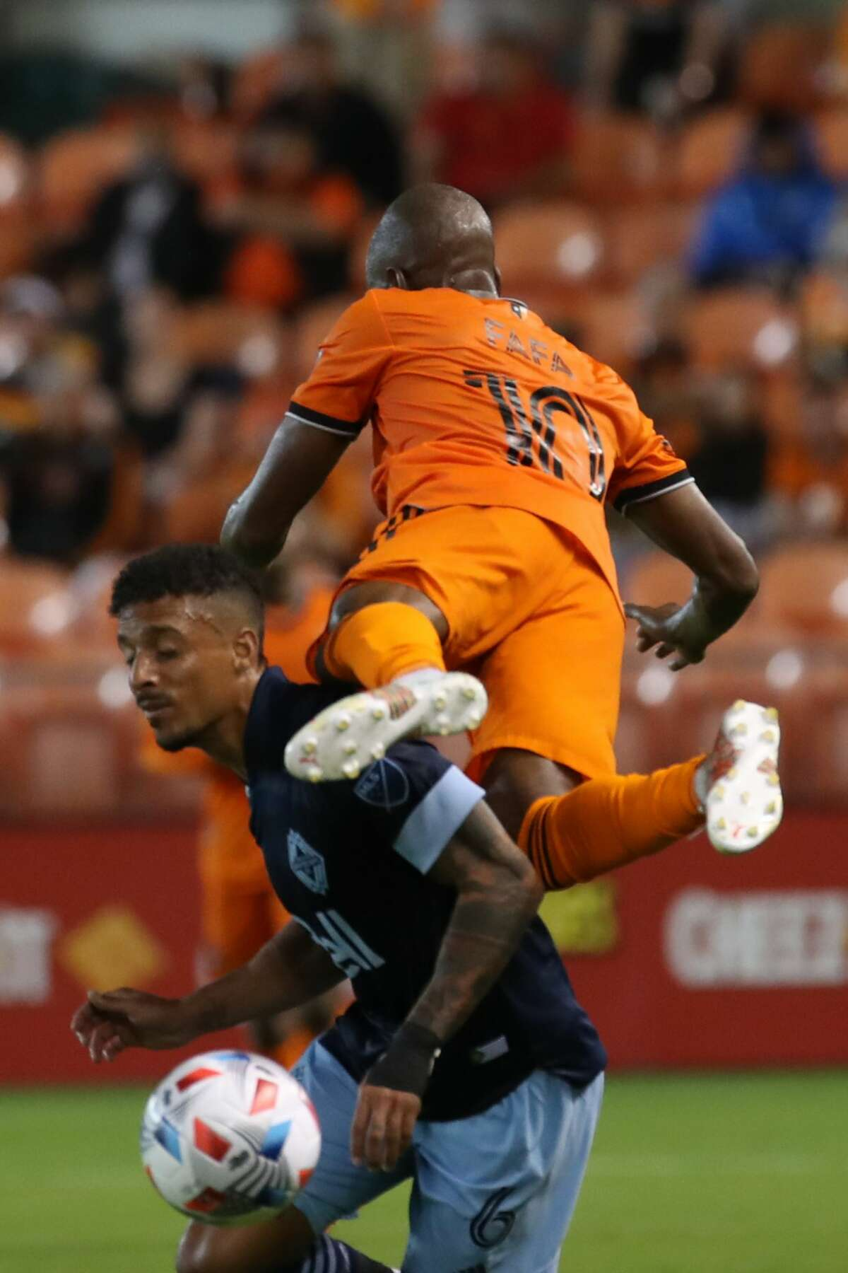 Houston Dynamo FC midfielder Fafa Picault (10) and Vancouver Whitecaps FC defender Bruno Gaspar (6) battle for control of the ball during the first half of an MLS match Saturday, May 22, 2021, at BBVA Stadium in Houston.
