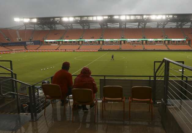 Fans wait for the rain to pass before the start of an MLS match between the Houston Dynamo FC and the Vancouver Whitecaps FC on Saturday, May 22, 2021, at BBVA Stadium in Houston. Photo: Jon Shapley/Staff Photographer / © 2021 Houston Chronicle