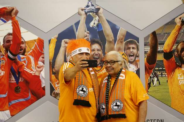 Alfredo O'Campo and his mother Ana Beltran take a selfie before an MLS match between the Houston Dynamo FC and the Vancouver Whitecaps FC on Saturday, May 22, 2021, at BBVA Stadium in Houston. Photo: Jon Shapley/Staff Photographer / © 2021 Houston Chronicle