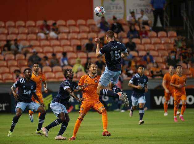 Vancouver Whitecaps FC defender Andy Rose (15) heads the ball over Houston Dynamo FC forward Maximiliano Urruti (37) during the second half of an MLS match Saturday, May 22, 2021, at BBVA Stadium in Houston. Photo: Jon Shapley/Staff Photographer / © 2021 Houston Chronicle