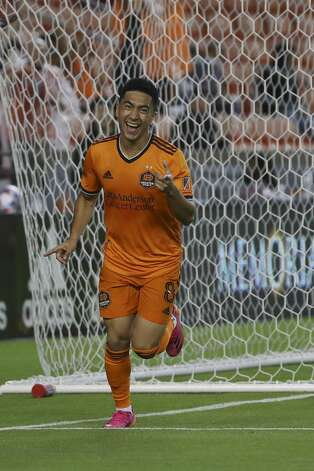 Houston Dynamo FC midfielder Memo Rodriguez (8) points at midfielder Fafa Picault (10) as he celebrates after scoring a goal during the first half of an MLS match Saturday, May 22, 2021, at BBVA Stadium in Houston. Photo: Jon Shapley/Staff Photographer / © 2021 Houston Chronicle