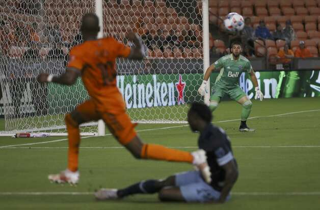 Vancouver Whitecaps FC goalkeeper Maxime Crepeau (16) watches as a shot from Houston Dynamo FC midfielder Fafa Picault (10) comes toward the goal during the first half of an MLS match Saturday, May 22, 2021, at BBVA Stadium in Houston. Photo: Jon Shapley/Staff Photographer / © 2021 Houston Chronicle