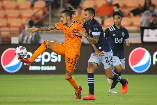 Houston Dynamo FC forward Maximiliano Urruti (37) and Vancouver Whitecaps FC defender Erik Godoy (22) fight for control of the ball during the second half of an MLS match Saturday, May 22, 2021, at BBVA Stadium in Houston. Photo: Jon Shapley/Staff Photographer / © 2021 Houston Chronicle