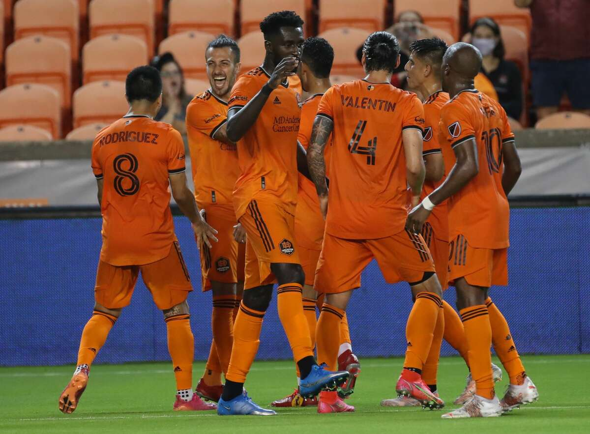 Houston Dynamo FC forward Maximiliano Urruti (37) and teammates celebrate after he scored a goal during the first half of an MLS match Saturday, May 22, 2021, at BBVA Stadium in Houston.