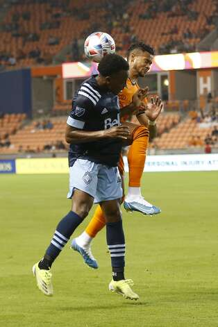 Houston Dynamo FC forward Ariel Lassiter (11) and Vancouver Whitecaps FC defender Javain Brown (23) battle for control of the ball during the second half of an MLS match Saturday, May 22, 2021, at BBVA Stadium in Houston. Photo: Jon Shapley/Staff Photographer / © 2021 Houston Chronicle