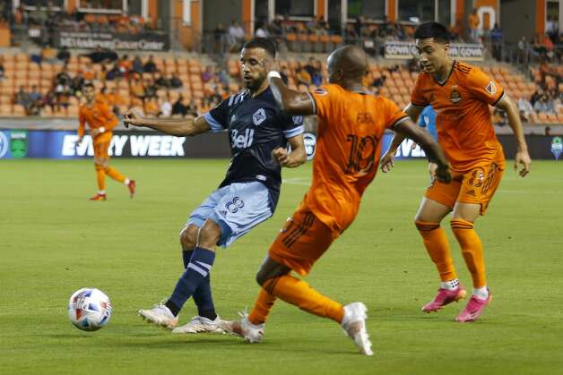 Vancouver Whitecaps FC midfielder Caio Alexandre (8), Houston Dynamo FC midfielder Fafa Picault (10) and midfielder Memo Rodriguez (8) battle for control of the ball during the first half of an MLS match Saturday, May 22, 2021, at BBVA Stadium in Houston. Photo: Jon Shapley/Staff Photographer / © 2021 Houston Chronicle