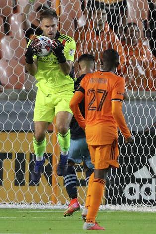 Houston Dynamo FC goalkeeper Marko Maric (1) blocks a shot on the goal during the second half of an MLS match Saturday, May 22, 2021, at BBVA Stadium in Houston. Photo: Jon Shapley/Staff Photographer / © 2021 Houston Chronicle