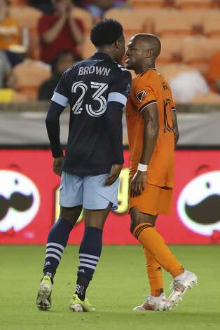 Vancouver Whitecaps FC defender Javain Brown (23) and Houston Dynamo FC midfielder Fafa Picault (10) exchange words during the first half of an MLS match Saturday, May 22, 2021, at BBVA Stadium in Houston. Photo: Jon Shapley/Staff Photographer / © 2021 Houston Chronicle