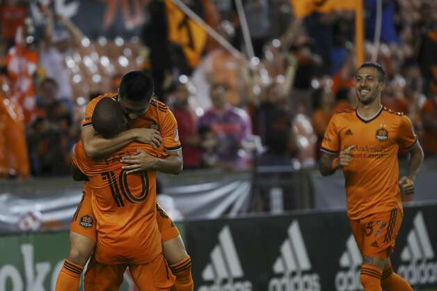 Houston Dynamo FC midfielder Memo Rodriguez (8) celebrates with midfielder Fafa Picault (10) after he scored a goal during the first half of an MLS match Saturday, May 22, 2021, at BBVA Stadium in Houston. Photo: Jon Shapley/Staff Photographer / © 2021 Houston Chronicle
