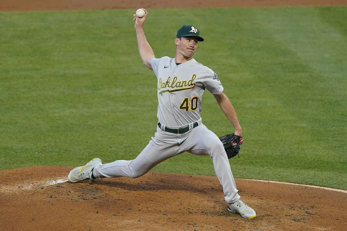 Oakland Athletics starting pitcher Chris Bassitt (40) throws during the first inning of a baseball game against the Los Angeles Angels Saturday, May 22, 2021, in Anaheim, Calif. (AP Photo/Ashley Landis)