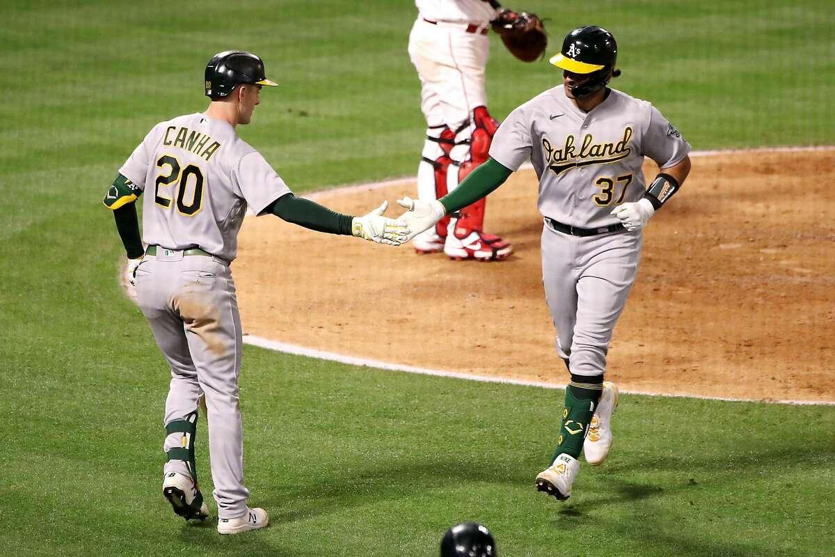 ANAHEIM, CALIFORNIA - MAY 22: Aramis Garcia #37 of the Oakland Athletics celebrates his home run with Mark Canha #20 during the seventh inning against the Los Angeles Angels at Angel Stadium of Anaheim on May 22, 2021 in Anaheim, California. (Photo by Katelyn Mulcahy/Getty Images)
