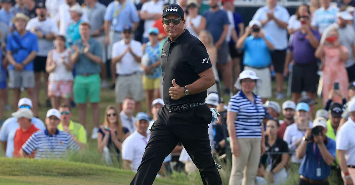 Phil Mickelson of the United States reacts with a thumbs up after playing his shot on to the 18th green during the third round of the 2021 PGA Championship at Kiawah Island Resort's Ocean Course on May 22, 2021 in Kiawah Island, South Carolina. (Photo by Sam Greenwood/Getty Images)