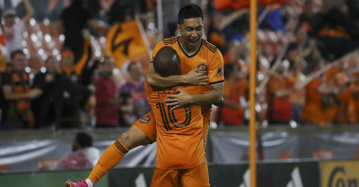 Houston Dynamo FC midfielder Memo Rodriguez (8) celebrates with midfielder Fafa Picault (10) after he scored a goal during the first half of an MLS match Saturday, May 22, 2021, at BBVA Stadium in Houston.